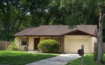 •Click for larger view of this Yellow Home, with a brown roof and brown trim•
